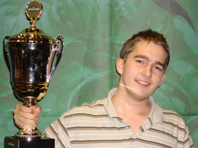A young(er) Seth Manfield hoists the Grand Prix Daytona Champion trophy in 2007.