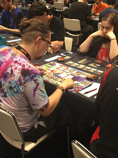 Alexis Ostrander plays a match on the main floor of Pro Tour Hour of Devastation